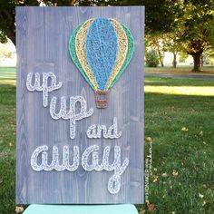 This listing is for a made to order string art Up Up and Away sign measuring approximately 18 x 27. Board will be stained gray (as pictured above) unless otherwise requested. Please list your color choice in the note to seller. String color options can be seen on the last picture. This board was made for a baby boys nursery but colors in the balloon could easily be adjusted for a girls room or to be gender neutral. Looking for a board that only has a hot air balloon? Find that listing here…