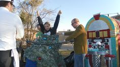 rockin around the christmas tree float ideas | Helping Amelia get into the tree costume before the float judging.