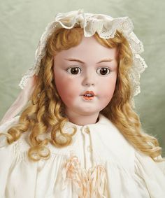 """Outstanding German Bisque Character,1279,by Simon & Halbig in Grand Size  34"""" (86 cm.) Mark: S&H 1279 dep Germany 15. Comments: Simon and Halbig,circa 1895. Value Points: rare model with superb details of sculpting including modeled brows,large eyes,impressed dimples,finest quality of bisque and painting,original body and body finish."""