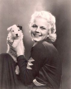 0 jean harlow holding a terrier puppy