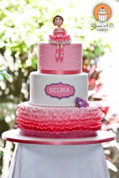 Ballerina themed birthday cake in pink, white and with a touch of purple.