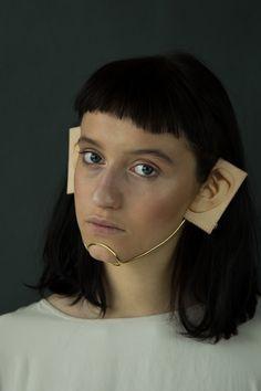 Akiko Shinzato Piece: Putting on Someone's Identity, 2015 Brass, laser engraved leather, reflective plastic