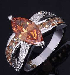 SOLD Stunning Marquis Champagne Sim Topaz 10KT WGF Ring is going up for auction at 12pm Thu, Sept 5 with a starting bid of $12.