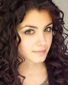 Green eyes, curly dark hair
