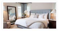 love love love the colors and pillows in this bedroom by Kate Marnell Interiors!