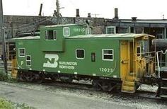 Classic Burlington Northern green and yellow colors. Steel over hanging cupullia caboose.