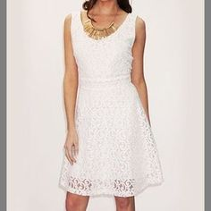 I just added this to my closet on Poshmark: Ivory lace fit & flare dress. Price: $13 Size: L