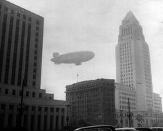 A hazy look at the Goodyear blimp as it travels past City Hall and through the smog surrounding downtown Los Angeles. East Los Angeles, Los Angeles Area, Downtown Los Angeles, Los Angeles Hollywood, Old Hollywood, California History, Southern California, Vintage California, California Usa