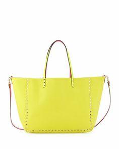 Rockstud Medium Reversible Canvas Tote Bag, Pink/Yellow by Valentino at Bergdorf Goodman.