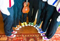 Rainbow Chuck Taylor Converse for the groomsmen to match their Bottle Top Pin color... (could even have bridesmaids in Chuck Taylor Converse too!)