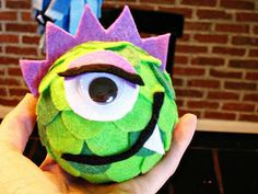 Monster faces to hang above table or anywhere....styrofoam ball, felt, glue gun....love it.