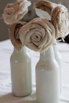 use this along with candle and a few flowers bulk up center piece and we can make these with spray painted beer bottles and burlap ourselves DIY Pretty Burlap Rose Tutorial