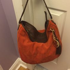 Michael Kors bag Beautiful orange bag has three pockets inside suede material leather handles and zipper .. Excellent condition .. Michael Kors Bags Shoulder Bags