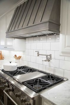 This covered range hood is cool. (Fixer Upper Farmhouse Kitchen by Chip and Joanna Gaines - Gray Stained Wood Covered Range Hood) Kitchen Hood Design, Kitchen Vent Hood, Kitchen Stove, Kitchen Redo, New Kitchen, Kitchen Range Hoods, Kitchen Paint, Kitchen Backsplash, Kitchen Exhaust