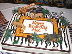 My kiddo's Animal Birthday cake with Schleich figurines