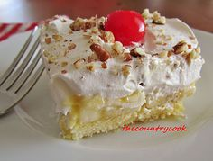 Twinkie Cake -  1 box of Twinkies,  4 Bananas peeled and sliced, 1 can-20 oz. crushed pineapples (drained well), 1 box -3 oz. Instant Vanilla Pudding, 2 cups cold milk 1 tub-8 oz. Whipped Topping, Maraschino cherries and chopped nuts, for topping...