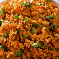 This easy recipe for Mexican rice is so full of flavor and better than any we've had from a Tex-Mex restaurant. Make some to go with your chicken enchiladas or tamale pie, and call it a night! Mexican Rice Recipes, Rice Recipes For Dinner, Easy Rice Recipes, Mexican Dishes, Healthy Recipes, Mexican Easy, Mexican Rice Recipe With Tomato Sauce, Baked Mexican Rice Recipe, Mexican Chicken With Rice