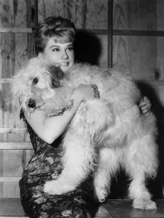 Doris Day knows that when your arms overflow with a big furry hug... it's glamorous.