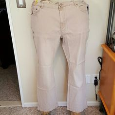 DG2 lightweight tan jeans with flag Ramie  cotton polyester spandex blend to give a linen like look. 5 pocket with rhinestone fly button. Rivet Embellishments on front pockets and rhinestone flag on one back pocket. Inseam 29.5 inches. Brand new with tags and never worn. Diane Gilman Pants Boot Cut & Flare