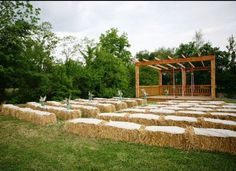 {Farm Wedding Ideas} Ceremony seating with blanket-covered hay.