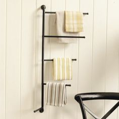 Everett Rack - The graduated arms swivel a full 180 so you can position them to fit virtually any space where you need extra hanging. The powder-coated finish resists moisture, so it's a good solution for the kitchen, mudroom, laundry room or bath.