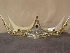 #11 - sterling silver and 24K gold vermeil with garnets   Exaggerated points and angle out shown here.  Darkride Jewels