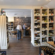 Wine shop rustic display equipment. Inn at home Newbury.                                                                                                                                                      More Wine Shop Interior, Shop Interior Design, Store Design, Visual Merchandising, Craft Beer Shop, Deli Shop, Whisky Shop, Shop Shelving, Wine Display