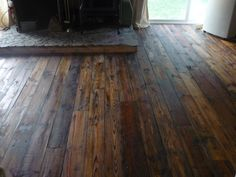 The Eclectic Cottage, the upcycled wood floors in the living room here at the Cottage.  This was originally sheathing from an old garage.  Powerwashed it, oiled it polyed it and nailed it in with hand cut nails.
