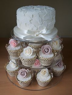 Pretty wedding cake with cupcakes