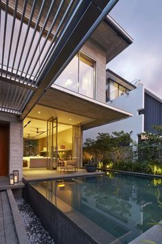 Complex Interplay of Elongated Interiors: Chiltern Drive House in Singapore