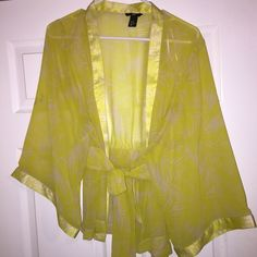 H&M coverup-cardi-top can be worn differently 100% polyester- fits a Medium-Large sleeves are wide regardless and it closes with straps H&M Tops Blouses