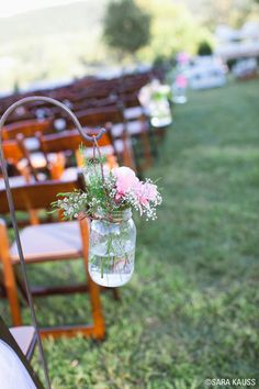 #DIYWedding Decor: Line the aisle with hanging mason jars and simple flower arrangements like Sarah Darling did. See more >> http://www.greatamericancountry.com/living/lifestyles/sarah-darlings-rustic-bohemian-wedding-pictures?soc=pinterest