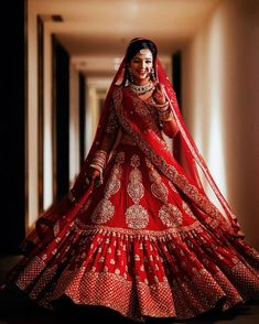 Beautiful Indian Bride in stunning red bridal lehenga! Picture Courtesy: The Wedding Conteurs Lehenga Wedding Bridal, Indian Wedding Lehenga, Wedding Lehenga Designs, Desi Wedding Dresses, Designer Bridal Lehenga, Bridal Lehenga Choli, Pakistani Bridal Dresses, Bridal Lehnga Red, Red Lehenga