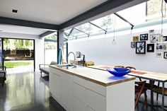 This house in Peckham, London, has a gorgeous light-filled kitchen extension. I love the concrete floor, steel beams and vintage furniture which just soften the modern lines slightly. House Extension Design, Glass Extension, Extension Ideas, Rear Extension, Design Patio, House Design, Open Plan Kitchen, New Kitchen, Quirky Kitchen