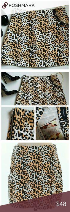 "MinkPink Cheetah Print Skirt - Medium New with tags. Mini cheetah print skirt by MINKPINK.  Size: Medium. Mix of orange, black & white. Measurements laying flat: 29.5"" Waist, 38"" Hips, 15"" Length.  Dual size zippers. 100% Cotton. MINKPINK Skirts"