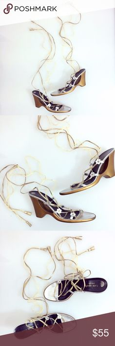 """Kate Spade ♠️ Lace Up Metallic Flower Heels Gorgeously feminine these lace-up heeled sandals finished with small flowers, cut-out sculpted heel, hemp & leather straps with tassel finished ends. Some signs of wear, (marks on heels, slight wear on footbed, and some exposed glue on fringe/strap, priced accordingly. Overall great condition as signs of wear are hardly if at all visible when worn. 3.5"""" Heel approximately 22"""" Tie strap length. kate spade Shoes"""