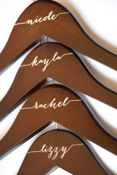 Engraved mahogany bridal party hangers by Black Label Decor