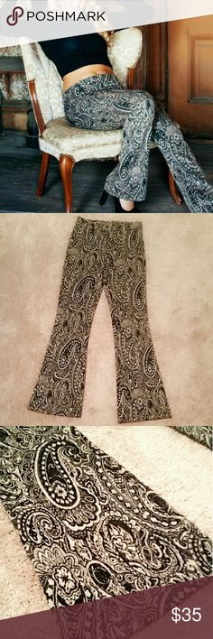 Cute high waisted bell bottoms Beautiful shimmery bell bottoms the material is like a mix between cotton and corduroy if that makes sense and they zip up on the side Pants