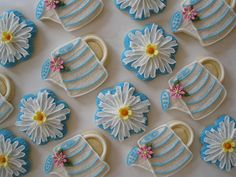 Cookies: flowers and sprinkling cans