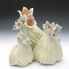 Carved porcelain sculpture with flowers in pastel by robertapolfus
