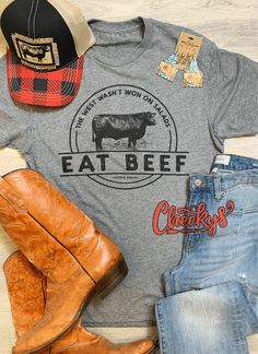 """""""Cheekys Original"""" ~ Eat Beef Unisex Tee on Gravel Road!! This tee is a crew-neck and a unisex fit. Please see the sizing chart for an accurate fit. 50% Polyester 25% Cotton 25% Rayon All images & designs are copyrights & we have worked very hard to make them. Please feel free to use our images for social media & sharing, but please give credit when doing so. Thank you for shopping with Cheekys!! Crew Neck, Beef, Social Media, Chart, Unisex, Amp, Fitness, How To Make, Cotton"""
