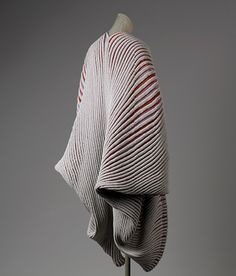 """Seashell"" or ""Shell-knit"" coat, spring/summer 1985  Issey Miyake (Japanese, born 1938)  Gray, pink, red, and lavender cotton/synthetic blend knit with heat-embossed ribbing"