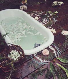 Boho style bathing, deck inset claw foot tub