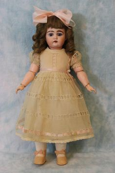 "Antique 15"" Beautiful German Bisque Child Doll 192 by Kammer and Reinhardt Circa 1895  Adorable child character #192 by K*R - Kammer and Reinhardt. This circa 1895 doll has no damage and no repairs.  Her bisque head has blue glass set eyes with all around painted lashes, open mouth with teeth, brushstroke eyebrows, dimpled chin, and rosy cheeks. Marked ""195//5"" on the back of the head."