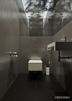 The bath keeps with the sleek themes using luxurious marble tiles and angular fixtures for a clean and polished look.