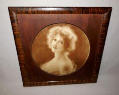 This is a vintage sepia print of a beautiful woman looking over her shoulder. It…