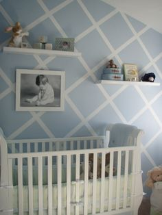 Soft baby blue & white baby boy nursery.  Love the lattice looking wall.