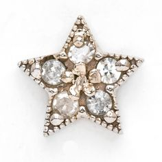 star earring 14K white gold and diamond. also available in yellow, rose gold orsterling silver. please note the price is for one individual piece.