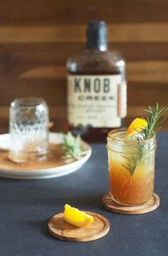 Bourbon Apple Cider with cinnamon sugar rim, rosemary sprig, and lemon wedge