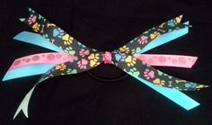 "AUCTION to Benefit JCAPL, Animal Rescue!  Puppy pawprints grosgrain ribbon, girls hair bow 5""W x 6""L - Beth Hutchinson, artisan  Link to view all auction items and place a bid: https://www.facebook.com/media/set/?set=a.10152703514929549.1073741859.74160789548&type=1"